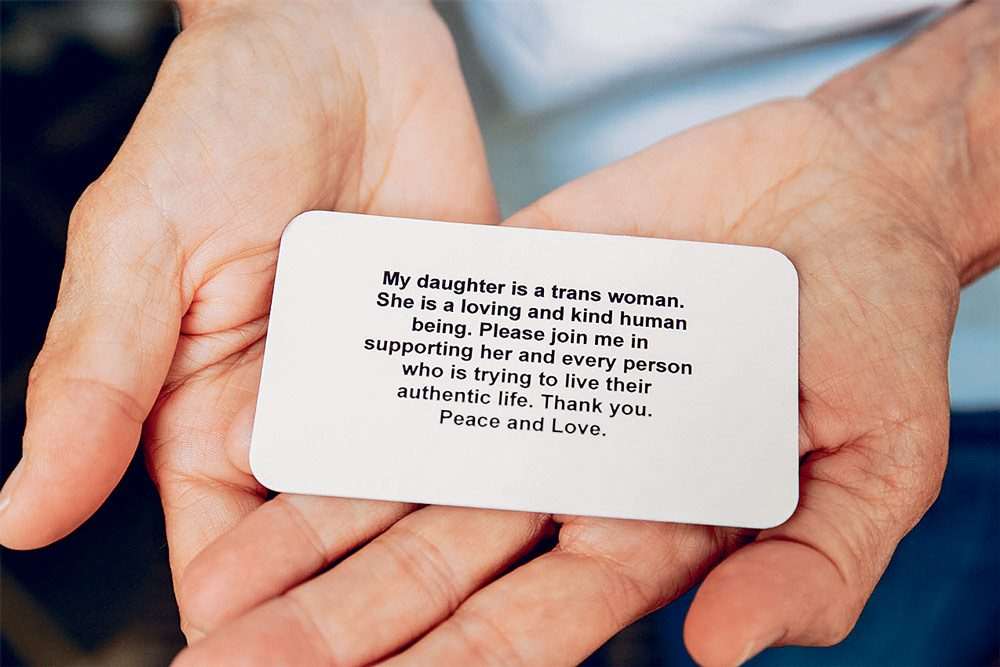 McGrath holding one of the cards she had printed up