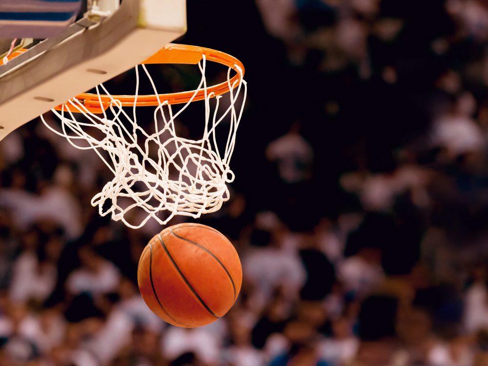 Basketball going through net at game