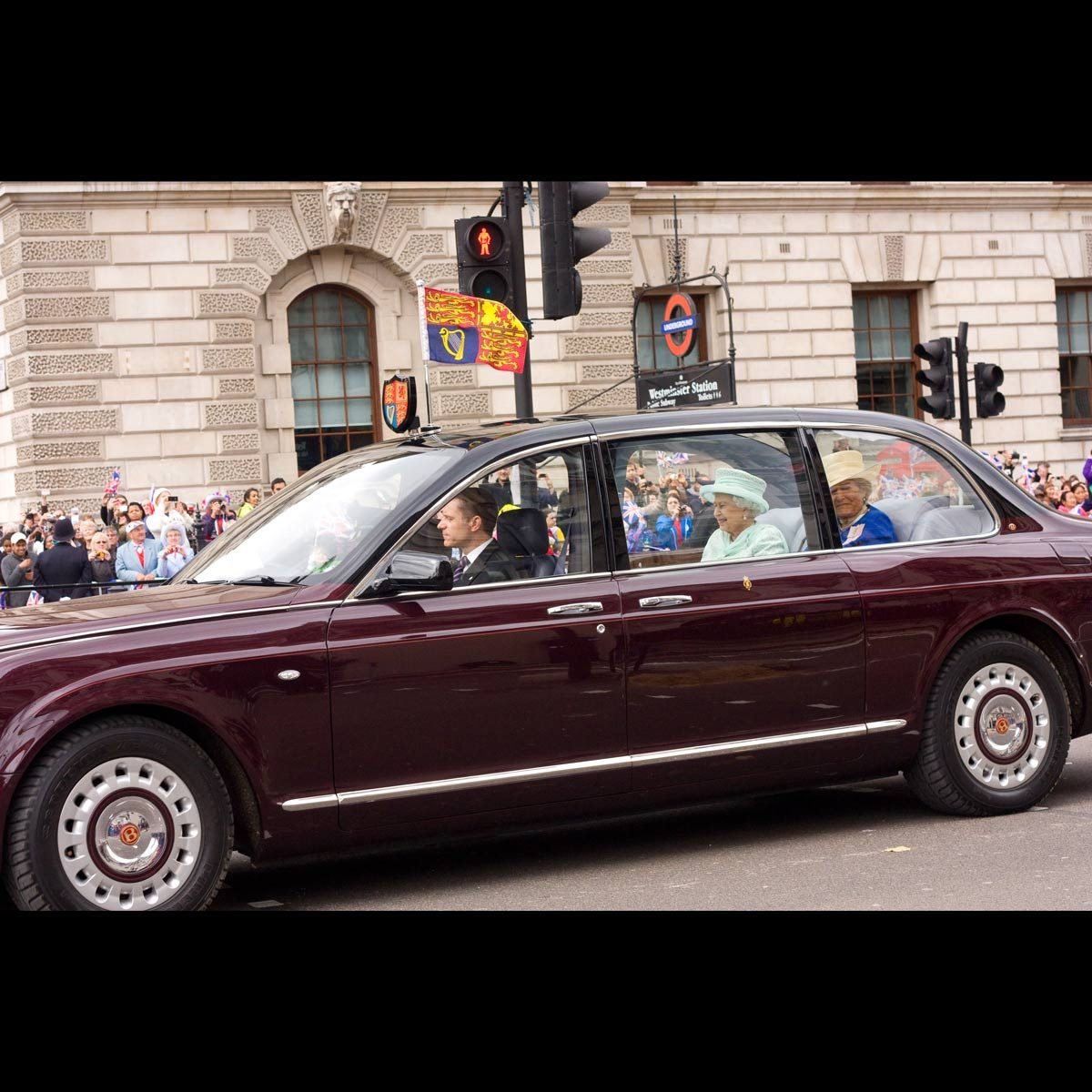 Queen Elizabeth rides in a Bentley