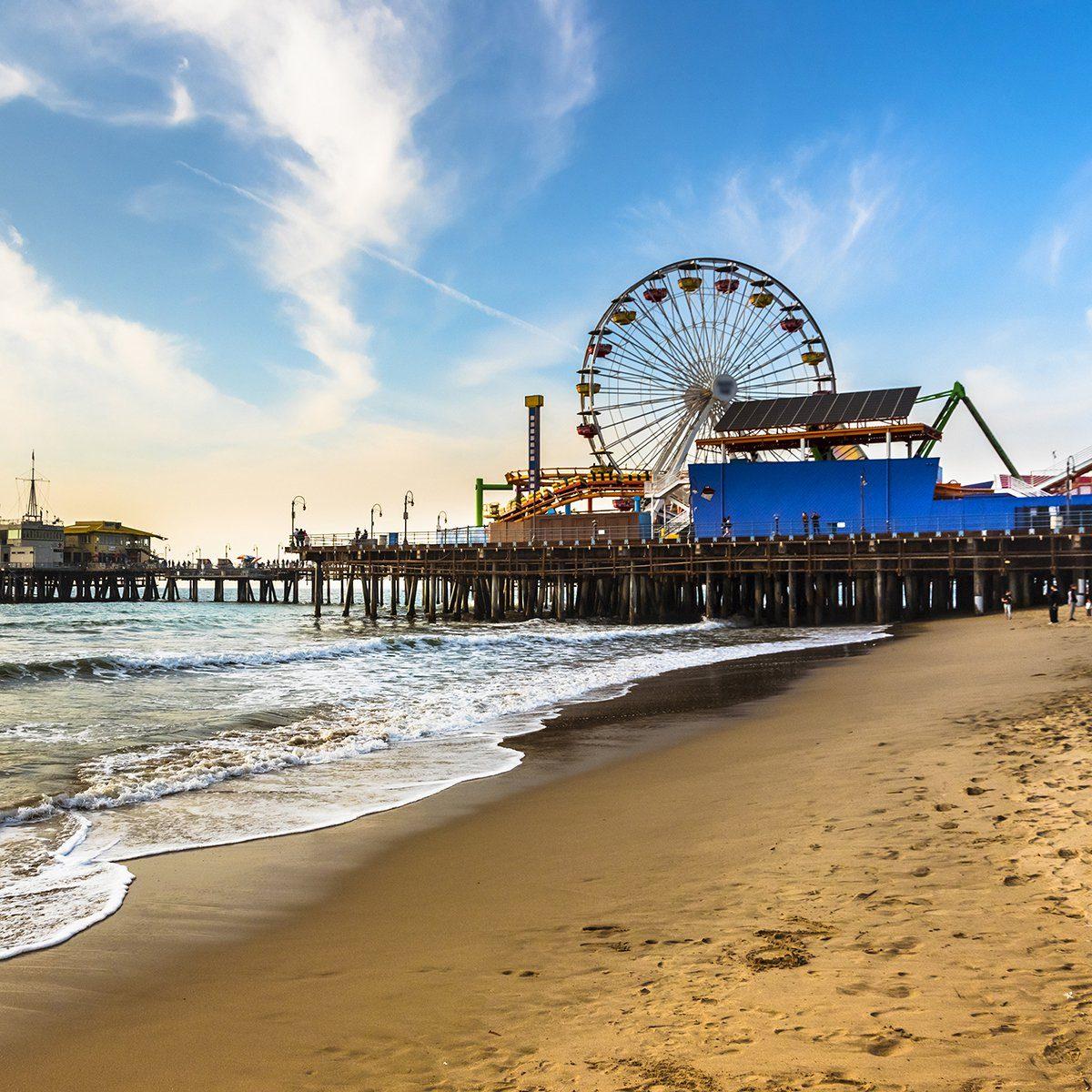 early morning winter Santa Monica pier beach sunny day
