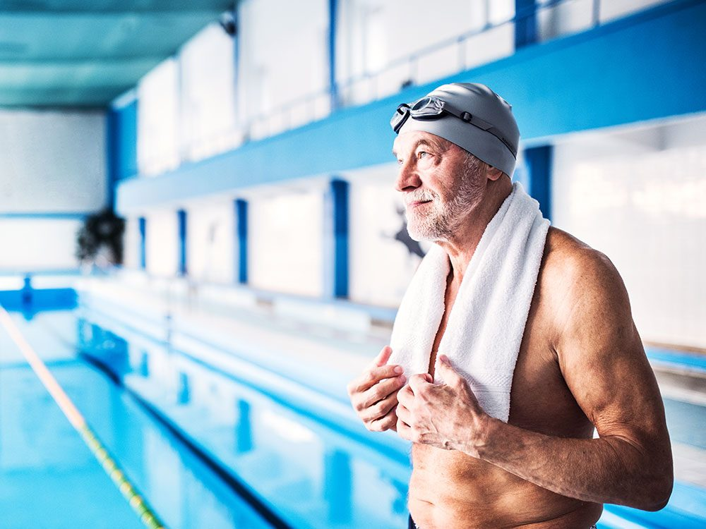 Fighting ageism - senior man swimming pool