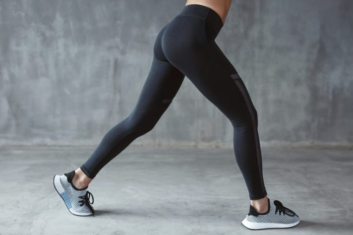 Fashion Sportswear. Fit Long Woman Legs In Leggings And Sneakers