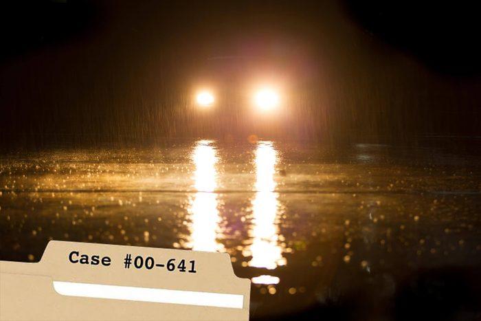 Car headlights on rainy night
