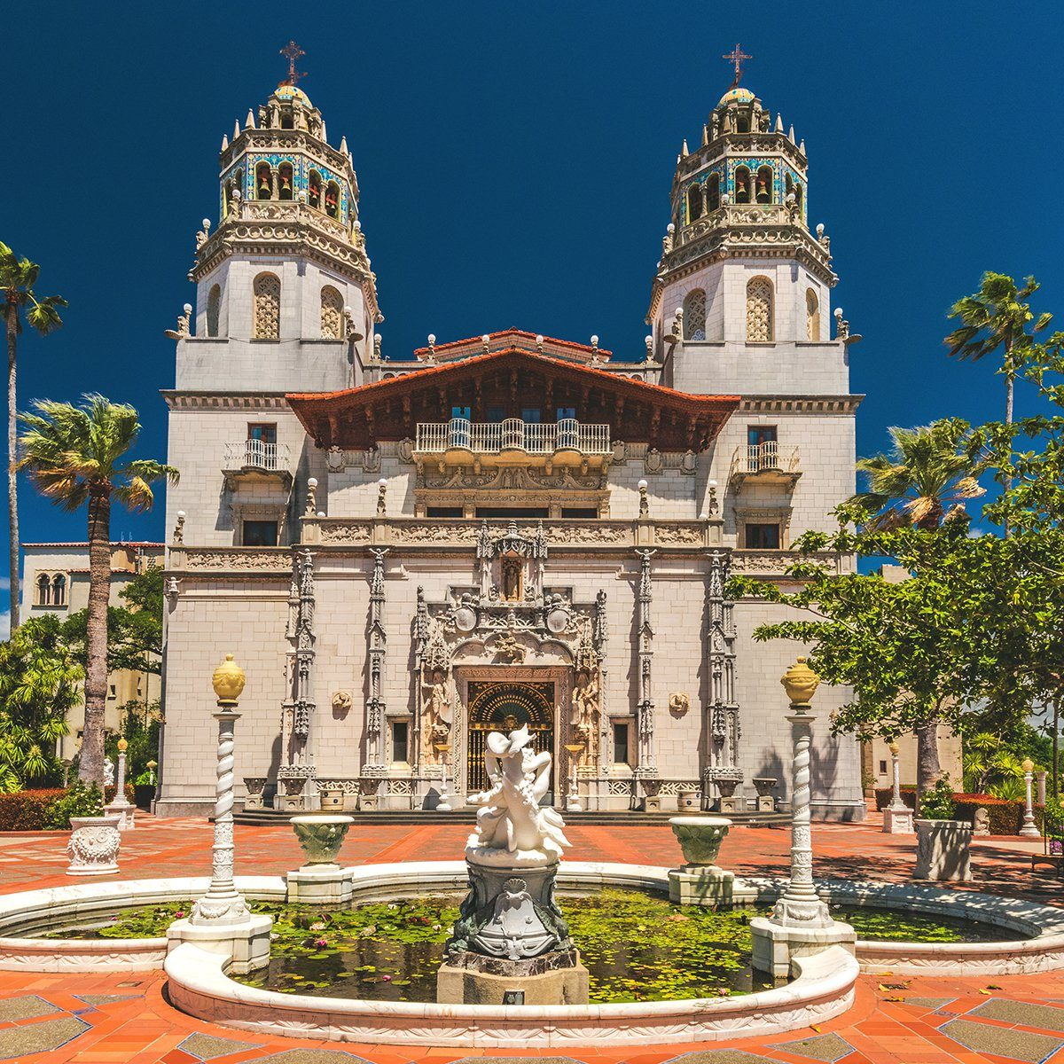 Exterior view of Hearst Castle, William Randolph Hearst's extravagant coastal hilltop estate designed by architect Julia Morgan over 28 years.