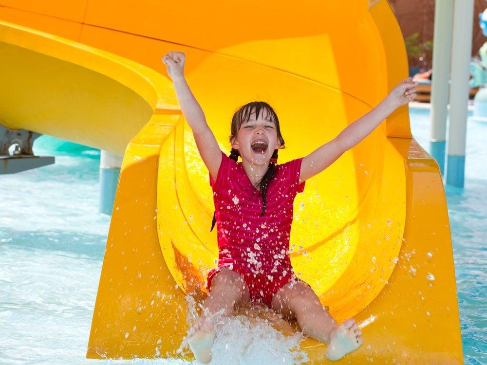 Little girl on slide at water park