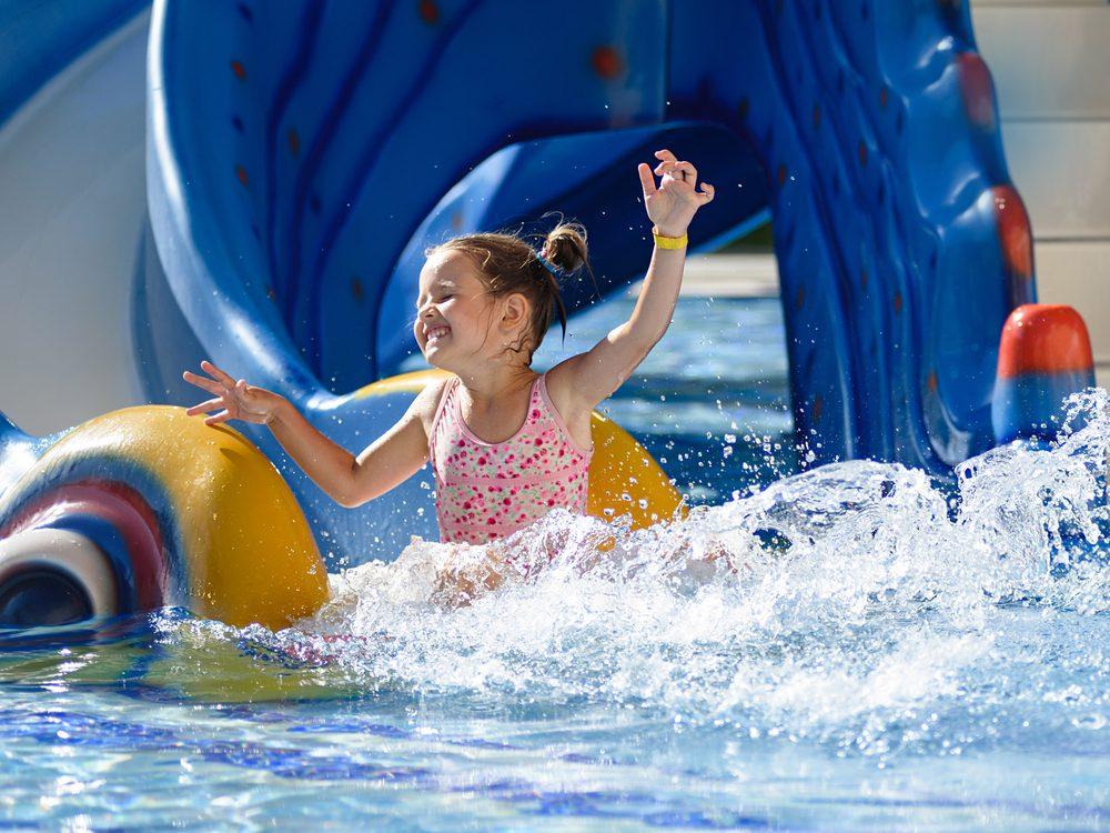 Girl sliding in pool