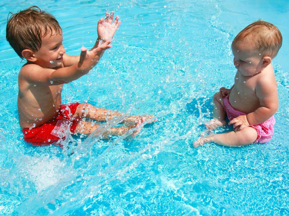 Toddlers playing in pool