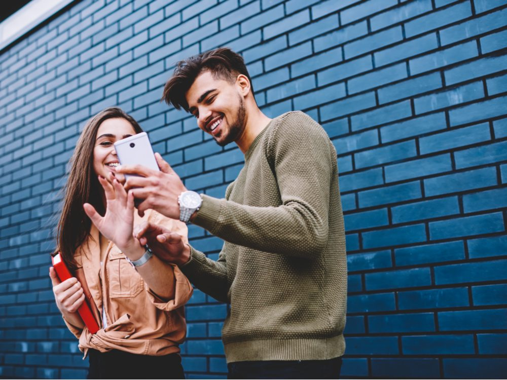 Couple playing with their smartphones