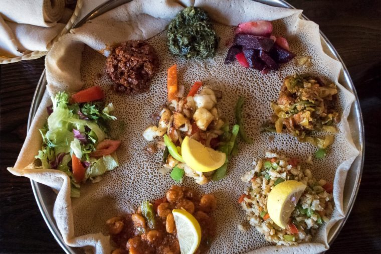 Injera is a sourdough flatbread made from teff flour. It is the national dish of Ethiopia, Eritrea, Somalia and Djibouti