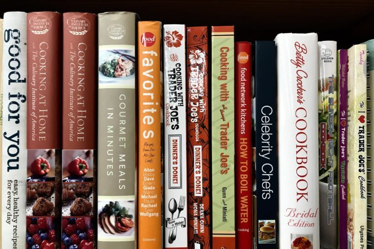 "Minneapolis, MN/USA. January 5th, 2019. Cookbooks on display on a shelf in Minneapolis including ""Cooking at Trader Joe's"" and "" Gourmet Meals in Minutes."""
