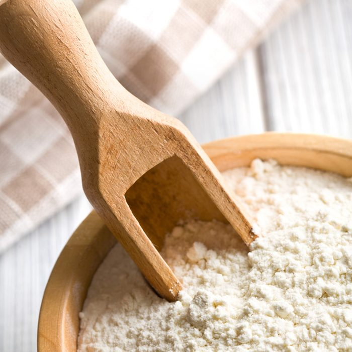 flour in wooden bowl on kitchen table; Shutterstock ID 127973471