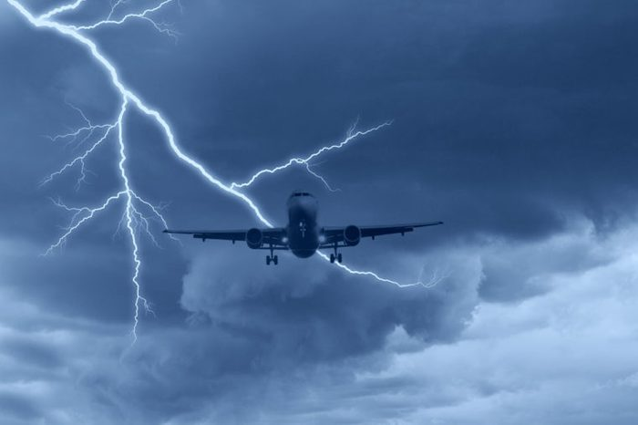 airplane in the sky with lightning