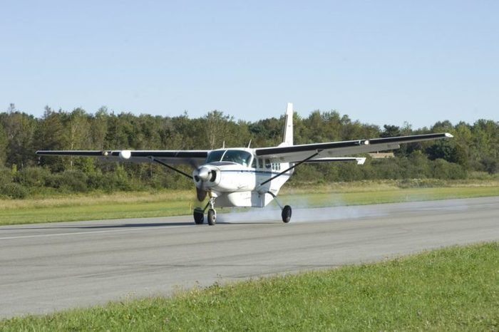 Small cargo plane landing at Owl's Head airport, Maine