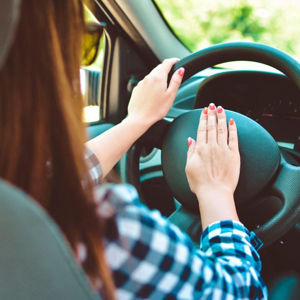 Woman honking horn