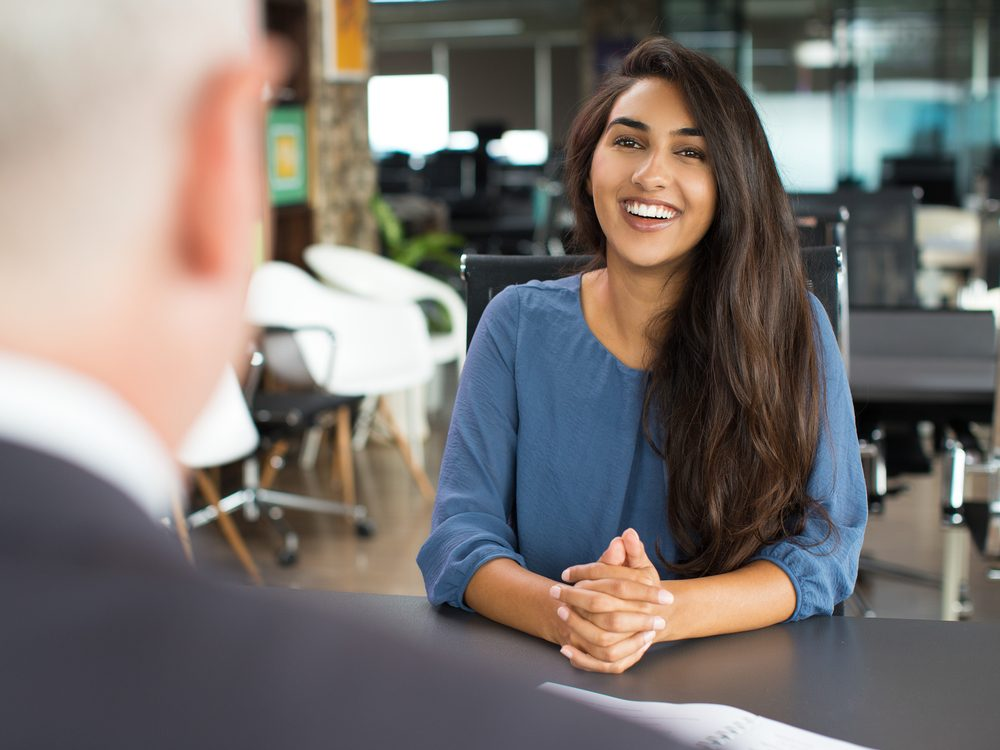 Young female candidate laughing at job interview