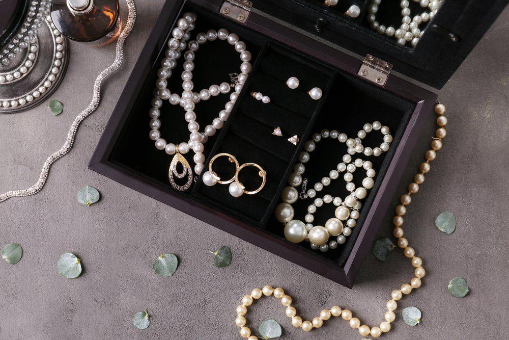 what do burglars want - Jewelry and box on gray background