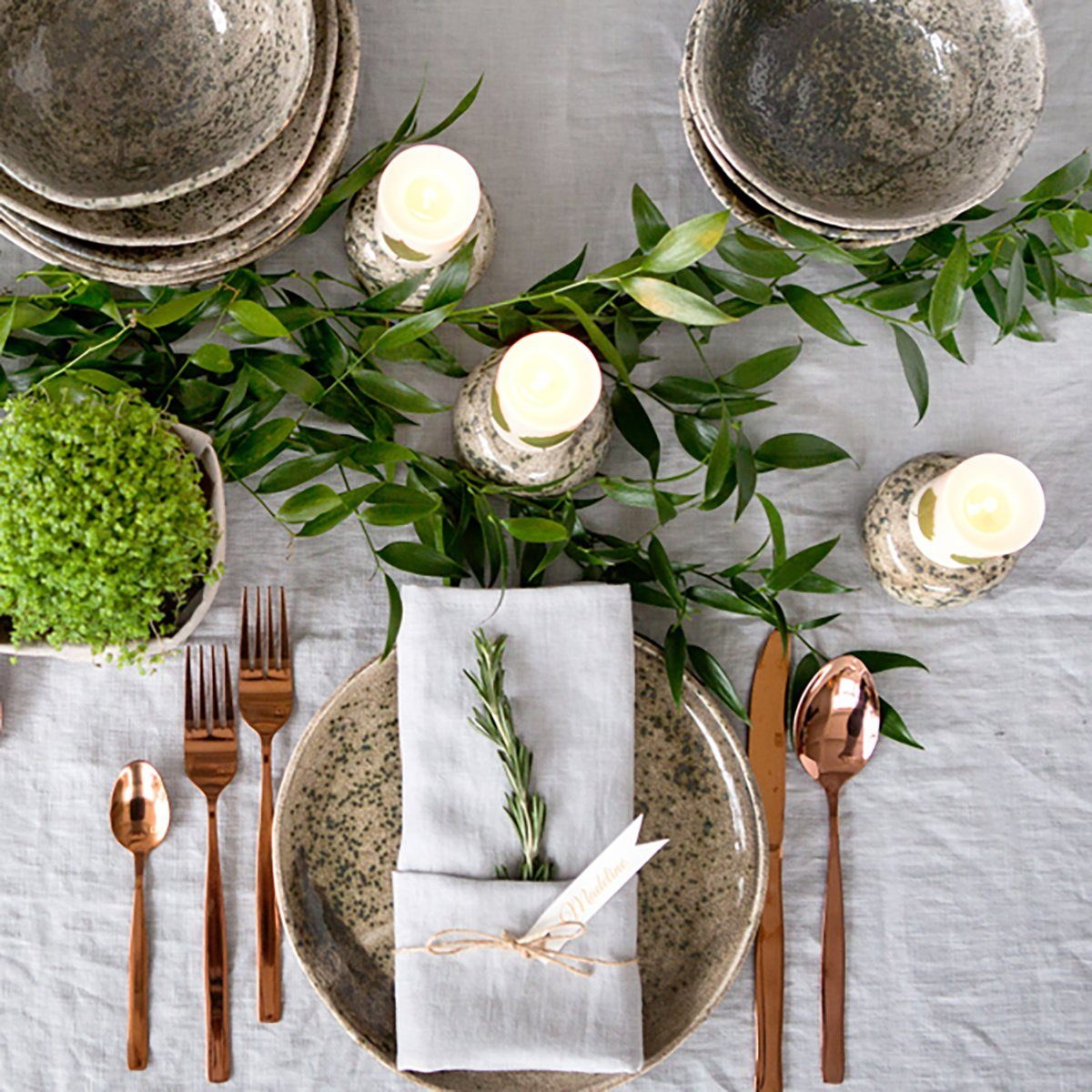 Holiday table setting with Linen napkins and rose gold cutlery