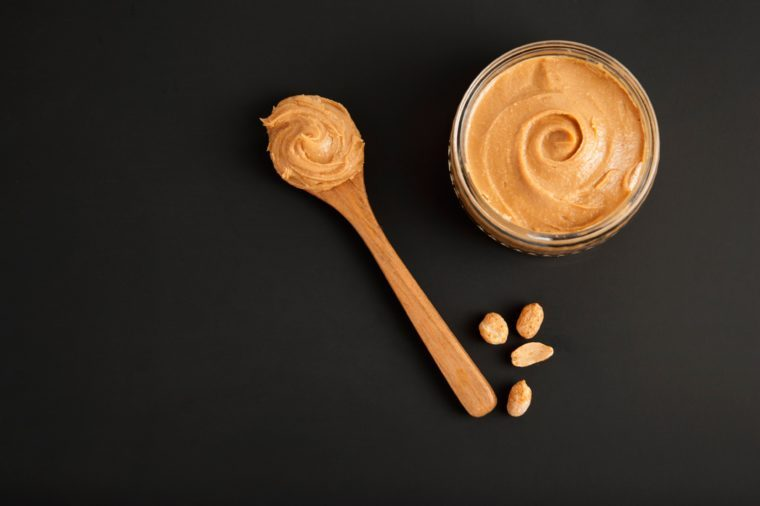 Peanuts and Fresh Peanut Butter Isoalted Black Background Protein Super Food Snack