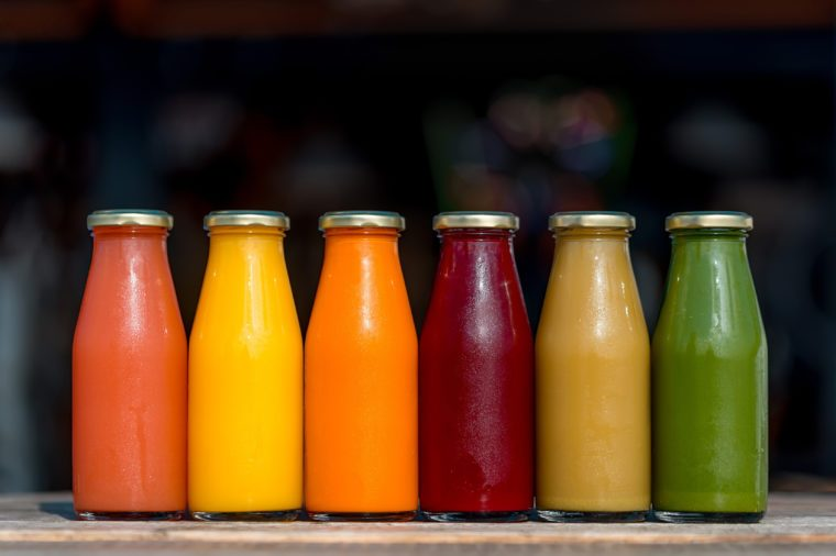 Raw vegetable and fruit juices in glass bottles