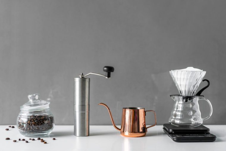 Coffee brewing tools in modern style for homemade on white table and grey background with copy space from home kitchen.