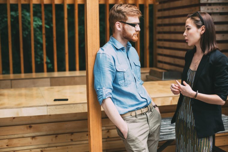 Man and woman talking. Discussion business ideas.