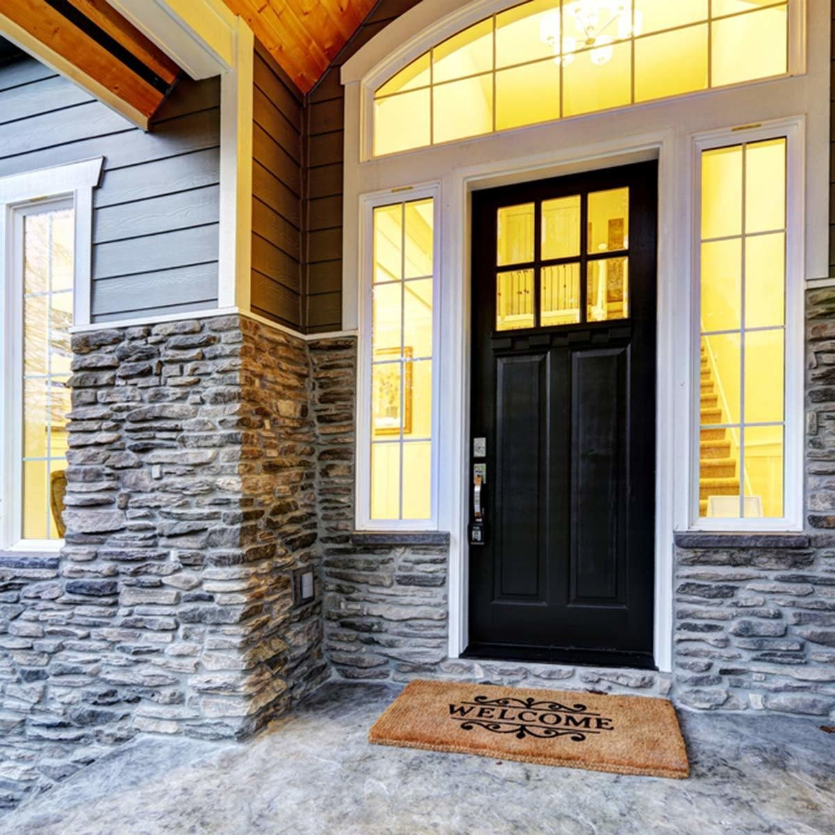 black front door stone work exterior