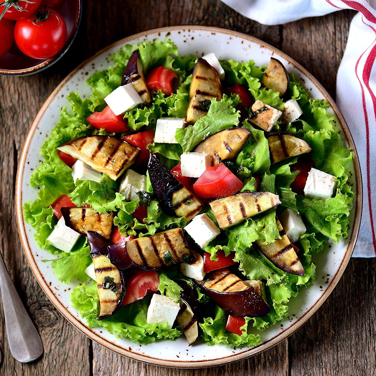 Grilled eggplant salad, tomatoes, feta and lettuce with olive oil and red balsamic, sea salt and pink pepper.