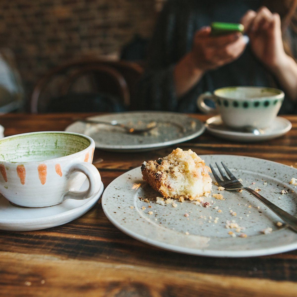 A dirty plate and an empty cup of coffee