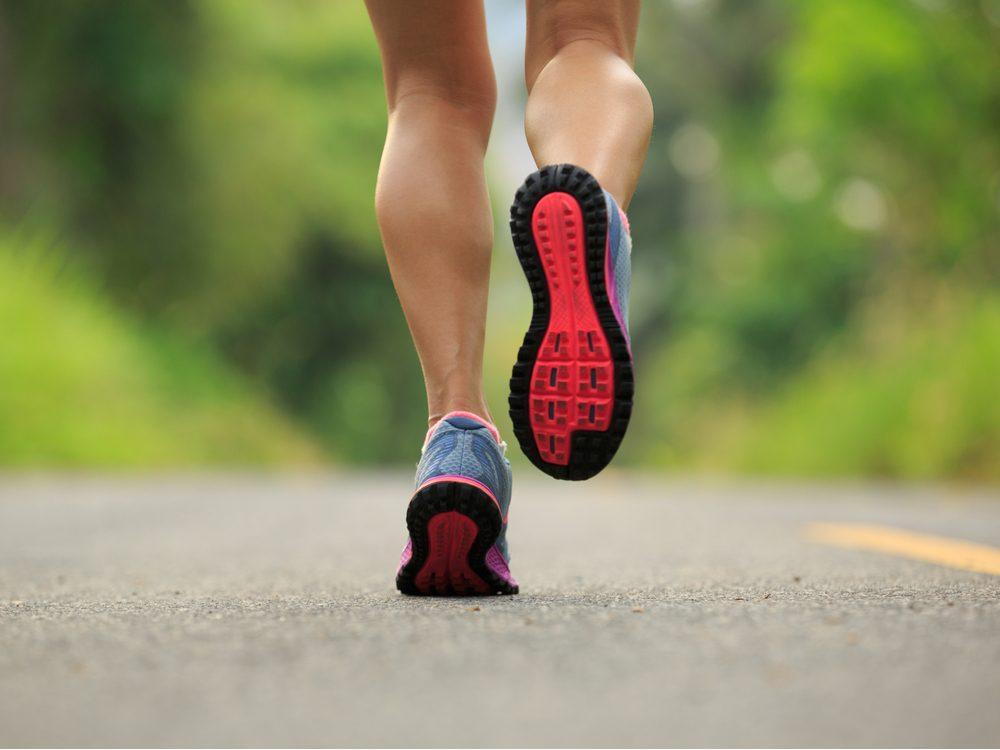Close-up of runner's legs