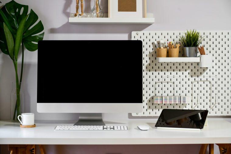 Loft workspace mockup desktop computer and minimal gadget.