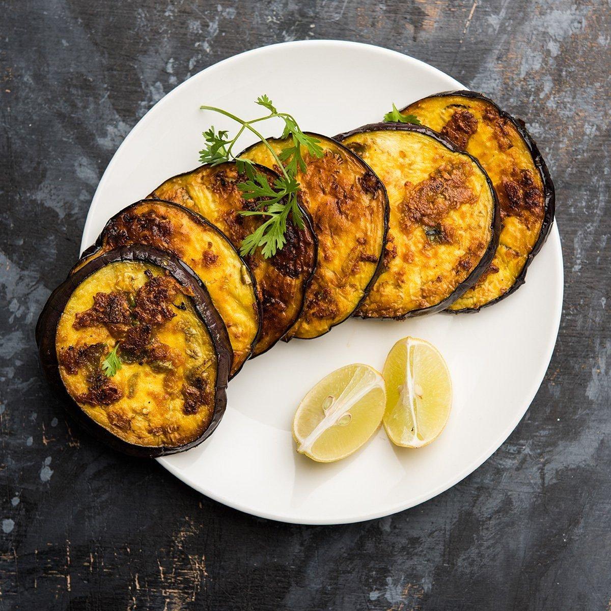 Pan fry crispy baigan / eggplant / brinjal recipe from India.