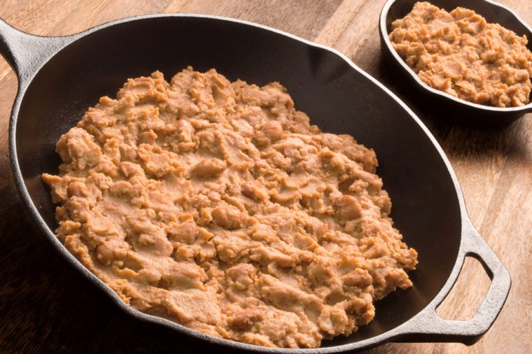 close up of a pan of refried beans