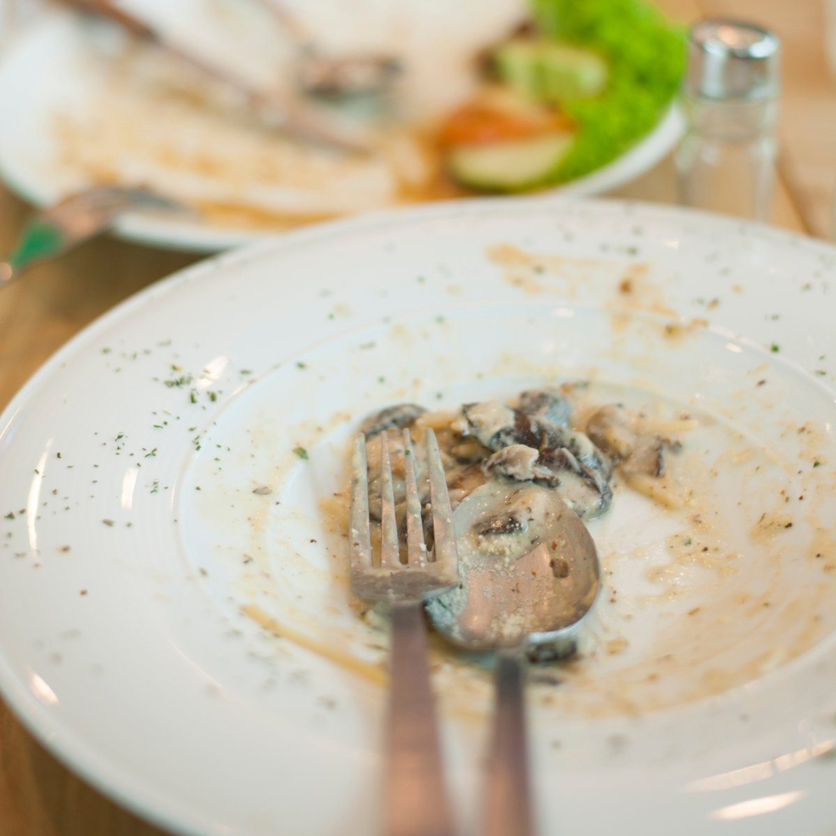 Some people had a good meal and almost finished up everything on the dining table in a cafe.