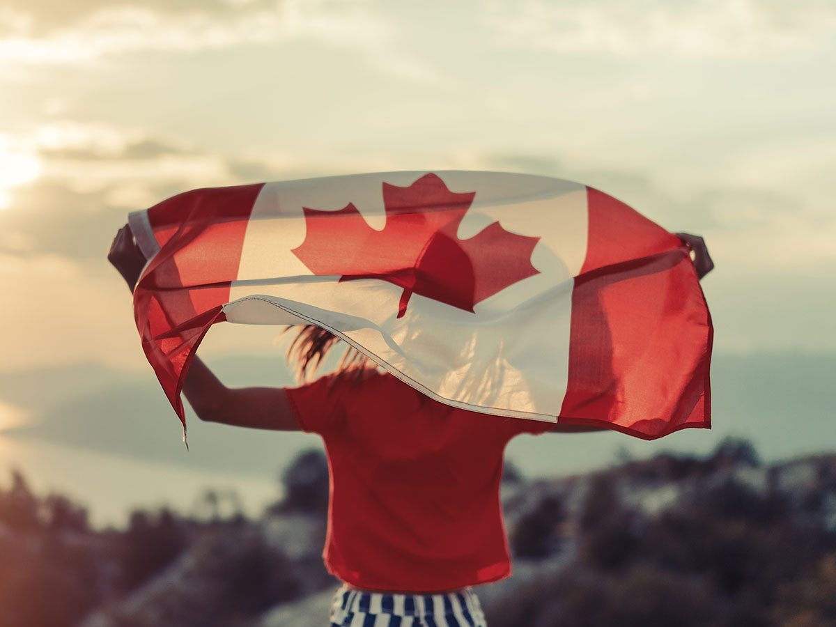 Woman carrying the Canadian flag