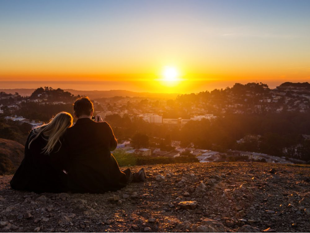 Couple watching the sunset in San Francisco