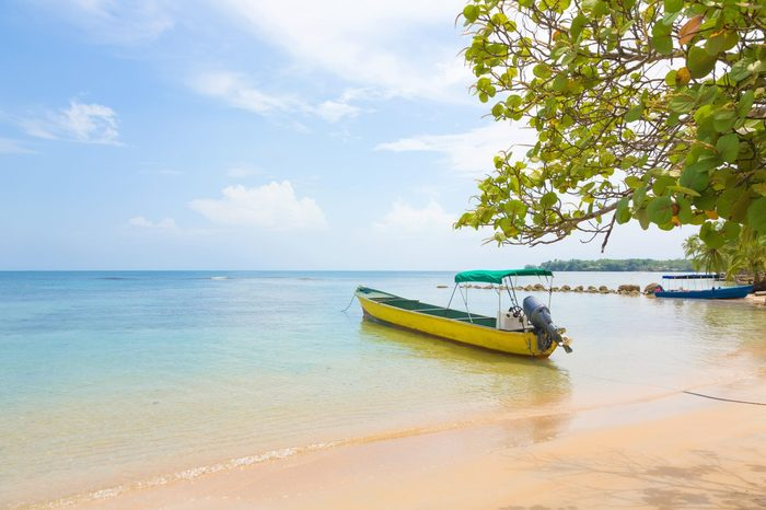 Boat at the beach of Boca del Drago, archipelago Bocas del Toro, Panama