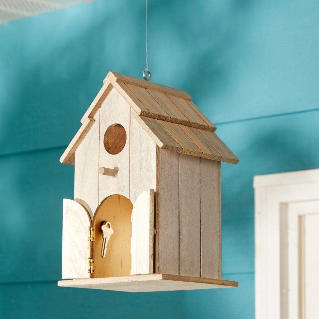 Hiding key in wooden birdhouse