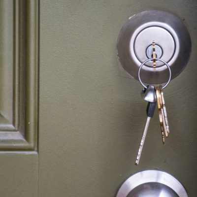 Home Ownership the day you get your new Keys to your new home. House keys inside door lock