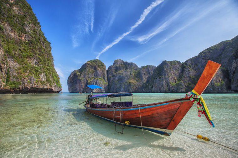 Maya beach with original long tail boat near phuket, Thailand