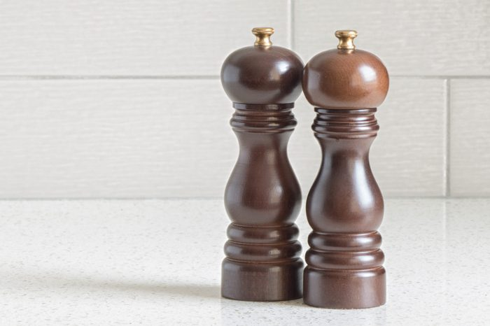 Wooden salt and pepper shakers on granite counter-top
