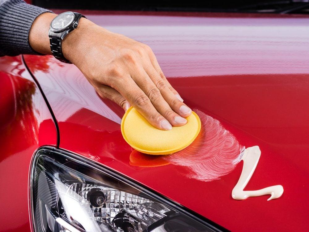 Applying wax to car