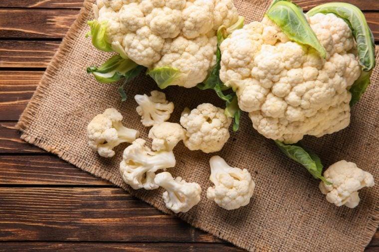 Fresh cauliflower on wooden table