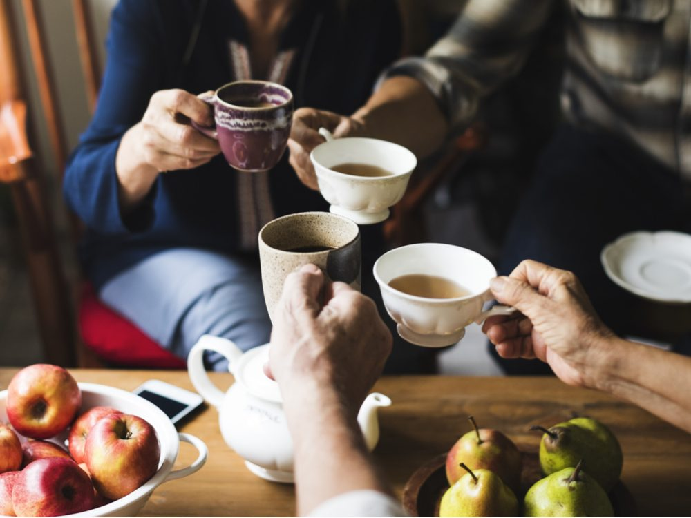 Group of diverse friends drinking tea