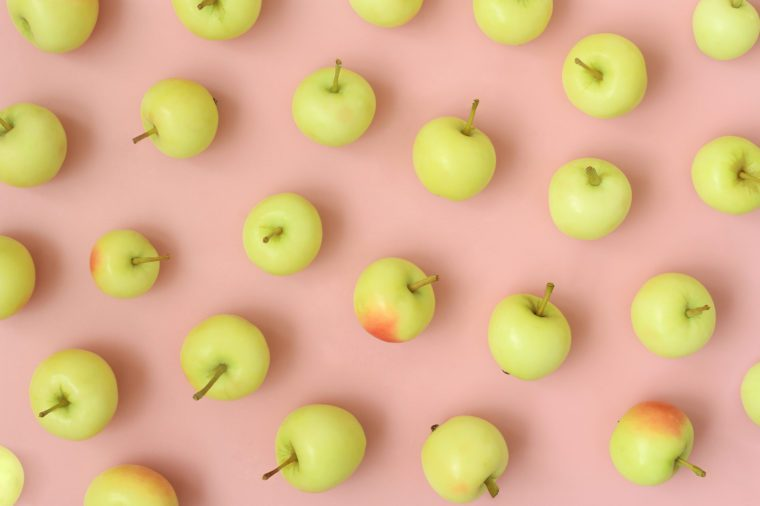 Apples on pink pastel background. Autumn, fall season. Top view, flat lay