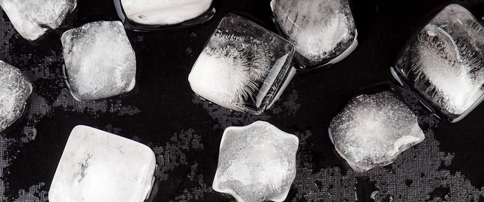 banner for website, Pieces of crushed ice cubes on black background. Including clipping path.