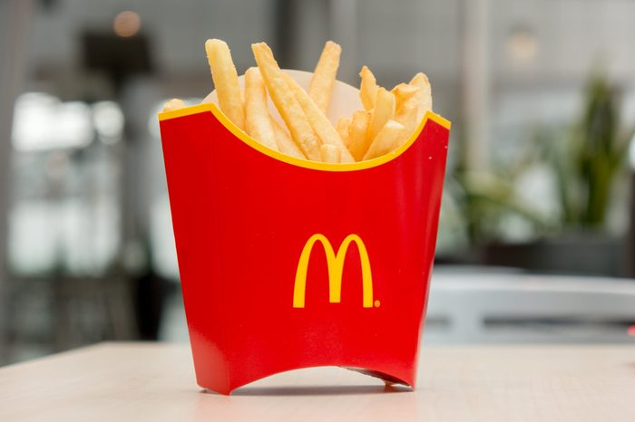 Moscow, Russia, March 15 2018: McDonald's potato french fries in the red box on wooden background