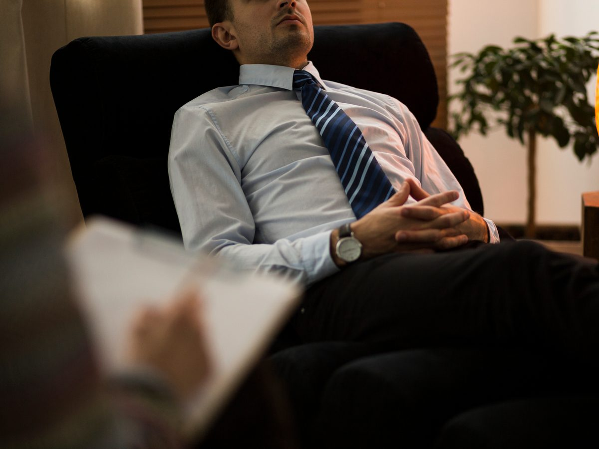 Health studies - burnt-out businessman in therapy