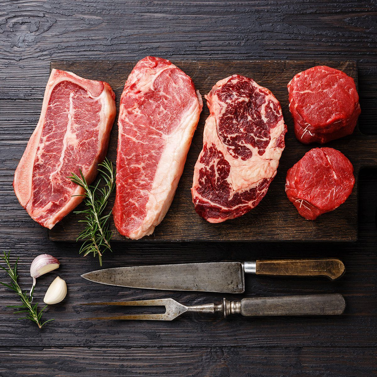 Variety of Raw Black Angus Prime meat steaks Blade on bone