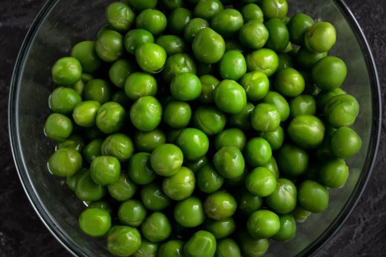 Buttered Peas. Green Peas on dark background.