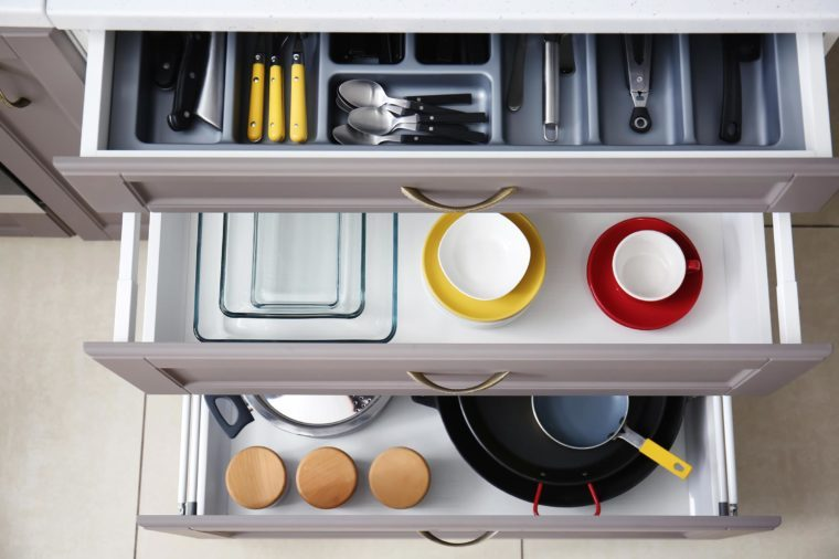 Set of clean kitchenware and utensils in drawersSet of clean kitchenware and utensils in drawers